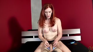 Red haired domina tortures and jerks off her slave's cock